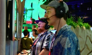 Gamers play Fortnite at the E3 gaming expo in Los Angeles.