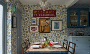 Winning patterns: the brightly papered kitchen with antique French table and solid wood units by deVOL.
