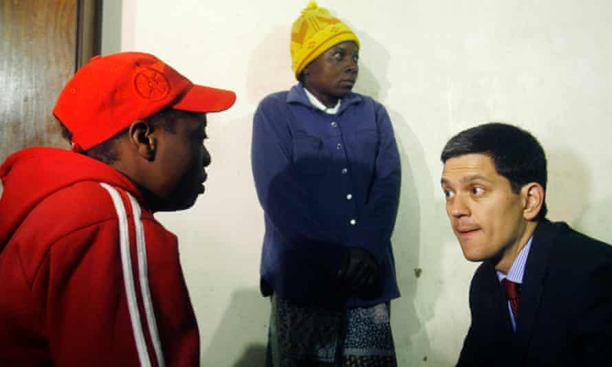 David Miliband with Zimbabwean refugees
