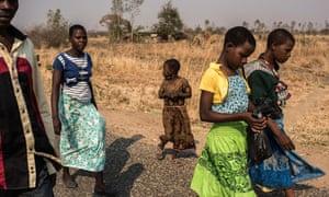 The Majawa family walk to church