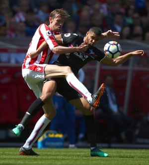 Stoke City's Peter Crouch battles Crystal Palace's Ruben Loftus-Cheek for the ball as Palace win 2-1 at the bet365 Stadium.