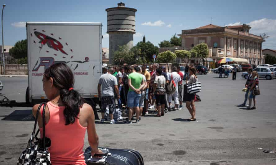 Migrant workers arriving at the bus station in the town of Vittoria