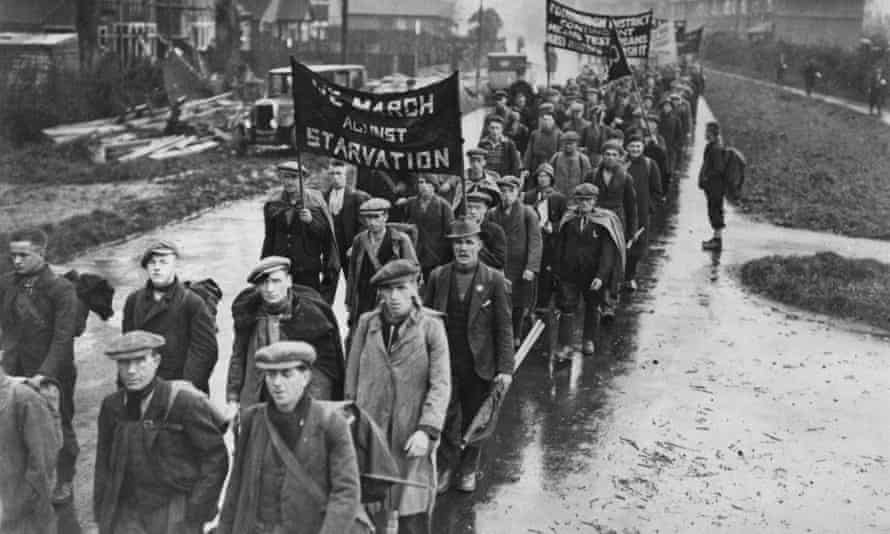 Unemployed men on a hunger march pass through a British town, circa 1935.