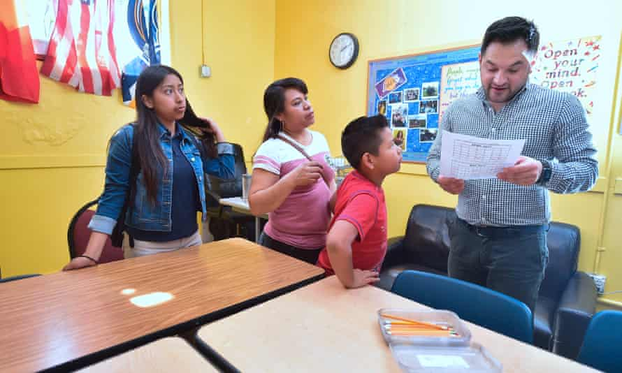 Marcelo Olmos, development director at Academia Avance charter school in Los Angeles, examines forms filled out during a parent engagement session.