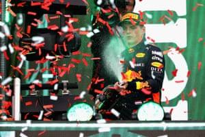 Verstappen celebrates on the podium.