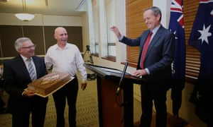 Meanwhile, opposition leader Bill Shorten is presented with a cake for his birthday while at a labor caucus meeting in Parliament House. He's 48 today.
