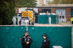 Police guard the site where 39 bodies were discovered in the back of a lorry at the Waterglade industrial park in Essex.