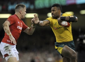 Australia's Samu Kerevi, right, attempts to fend off the tackle of Wales Gareth Anscombe.