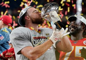 Travis Kelce celebrates with the Vince Lombardi trophy.