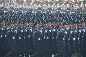 Chinese troops march during the parade in Beijing on 1 October