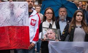 People take part in a silent march in memory of Arkadiusz Jóźwik