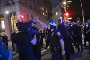A police officer shouts at the Associated Press videojournalist Robert Bumsted last week in New York.