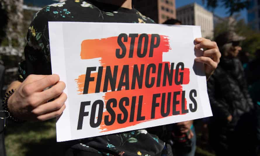 A sign protesting the IMF and World Bank investments in fossil fuels.