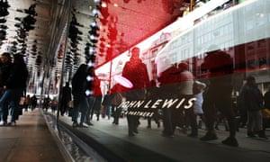 Shoppers pass a John Lewis on Oxford Street
