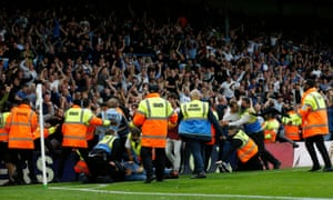 Stewards detain pitch invaders after West Ham United's Michail Antonio scored their second goal.