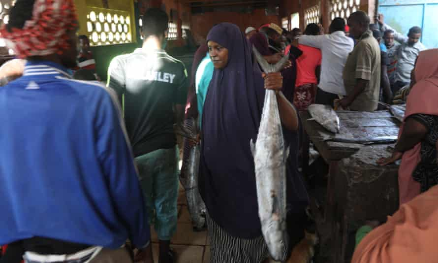 Fardowsa Mohamed Ahmed sells fish at a fish market in Mogadishu, Somalia