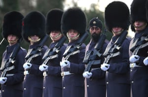 Sandhurst, UK. Troops look on as the French president, Emmanuel Macron, meets the British prime minister, Theresa May, at Sandhurst's Military Academy