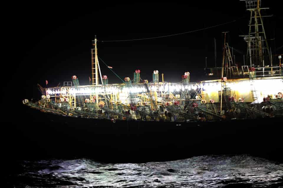 Vessels from the Chinese fishing fleet use bright lights to lure squid to the surface of the Pacific Ocean