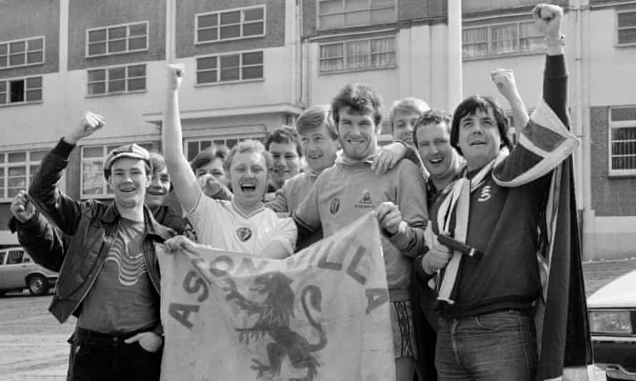 Aston Villa's Peter Withe and Ken McNaught pose with fans prior to the European Cup semi-final second leg against Anderlecht.