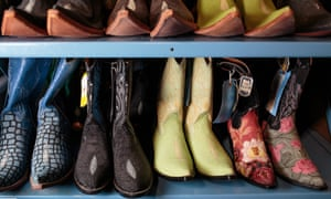 Contraband boots sit on shelves inside the National Wildlife Property Repository in Commerce City, Colorado, U.S., on Wednesday, May 31, 2017. Photographer: Matthew Staver