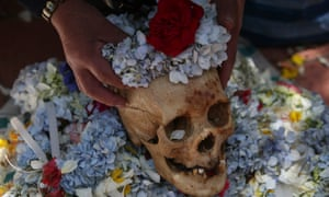 "A human skull during the Natitas Festival in a cemetery in La Paz. ""Natitas"" are human skulls from abandoned graves, whic when cared for and decorated are believed to protect one from evil."