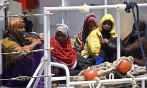 Migrants wait to disembark from a ship in Lampedusa, Italy, after they were rescued at sea.