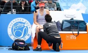 Maria Sharapova receives medical treatment during her Shenzhen Open quarter-final match against Aryna Sabalenka
