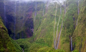 Waialeale crater with many waterfalls and green cliffs in Kauai, Hawaii, USA.