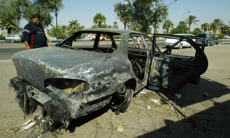A burnt car at the site where Blackwater guards opened fire on a crowd in Baghdad, Iraq, in 2007. Donald Trump has pardoned the four contractors jailed over the killing of 14 civilians.
