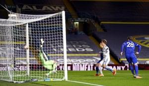 Kasper Schmeichel is beaten by the cross from Leeds United's Stuart Dallas.
