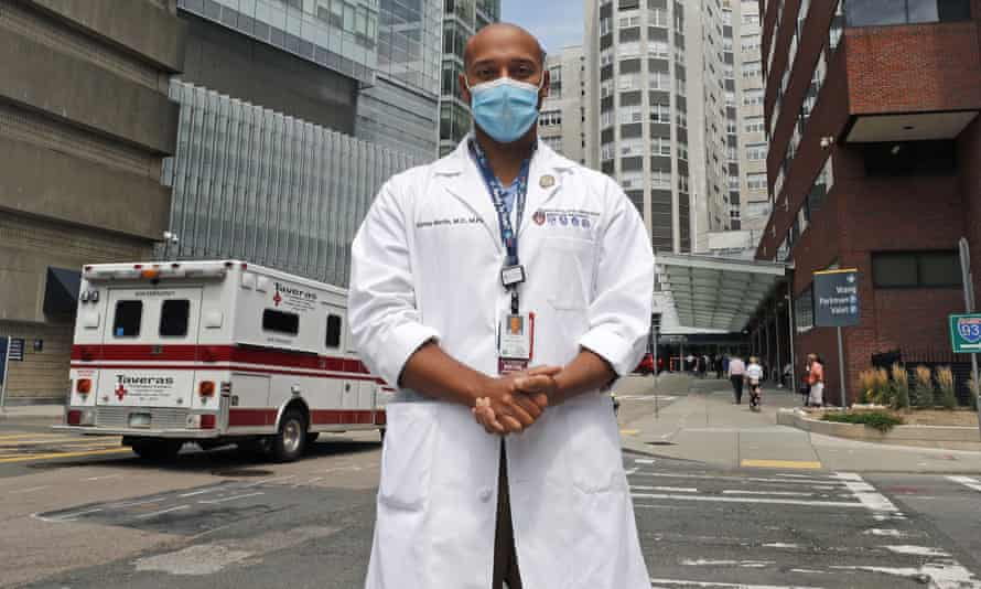 Alister Martin, an emergency room doctor at Massachusetts General Hospital, poses outside the hospital, in Boston