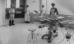 Nurses in the operating theatre at King's College hospital in London in 1914. The NHS is still stuck in the 20th century, it has been claimed.