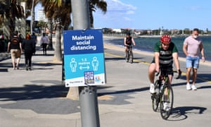 People exercise along the St Kilda beach foreshore in Melbourne
