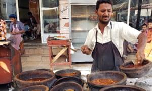 A Yemeni vendor prepares food at an outdoor restaurant in of al-Hudaydah.