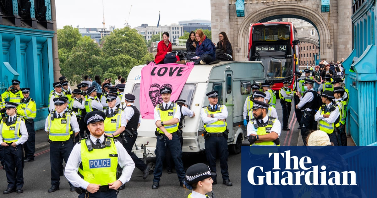 Extinction Rebellion protesters block Tower Bridge in London