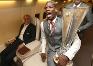 Paul Pogba and Manager Jose Mourinho of Manchester United celebrate with the Europa League trophy on the plane home after the UEFA Europa League Final match