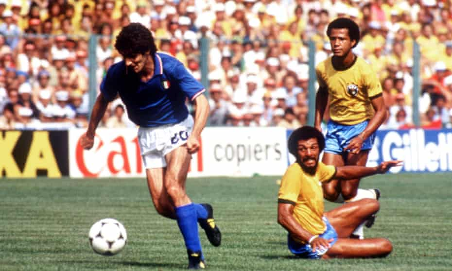 Paolo Rossi runs away from a pair of Brazil players