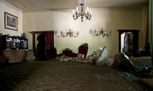 Sludge fills a living room after the overflowing of the Estero San Jose River in San Alfonso, Santiago.