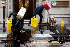 London, UKActivists from the climate action group Ocean Rebellion perform a stunt outside The Baltic Exchange building