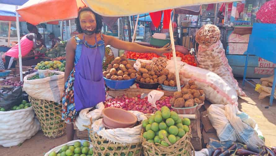 Teacher Racheal Namugaya and the market stall she started to support herself during Covid school closures.