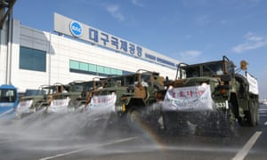 "South Korean army trucks spray disinfectant to prevent the spread of the new coronavirus in front of Daegu International Airport in Daegu, South Korea, Friday, March 6, 2020. Seoul expressed ""extreme regret"" Friday over Japan's ordering 14-day quarantines on all visitors from South Korea due to a surge in viral infections and warned of retaliation if Tokyo doesn't withdraw the restrictions."