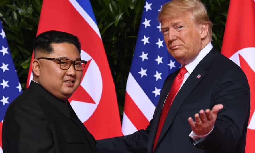 North Korea's Kim Jong-un meets Donald Trump at their summit in Singapore last year. A UN report says the regime is protecting its nuclear capabilities from US strikes.