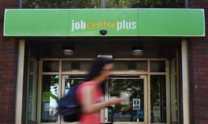 A pedestrian passes a Job Centre in London.