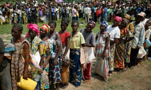 Internally displaced people wait for their rations at a World Food Programme food distribution point in Bangui, Central African Republic, 2014