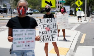 Middle school teacher Brittany Myers, center, stands in protest in front of the Hillsborough County Schools District Office on 16 July 16 in Tampa, Florida.