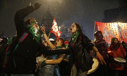 Women protest in the rain