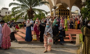 Thai Muslims celebrate Eid al-Fitr at The Foundation of the Islamic Centre of Thailand to mark the end of the holy month of Ramadan on 24 May 2020 in Bangkok, Thailand.