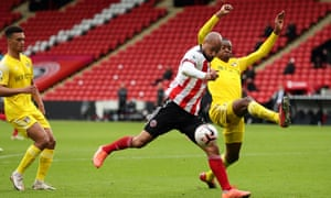 Fulham's Tosin Adarabioyo looks to block a shot from David McGoldrick of Sheffield United