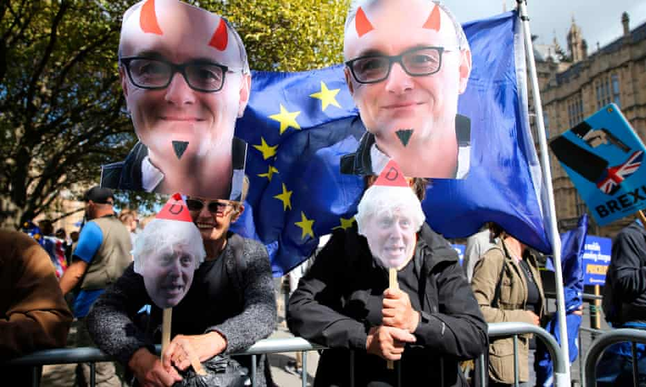 Remain demonstrators outside parliament last week with Dominic Cummings 'devil' masks.