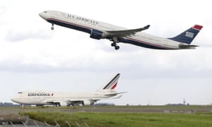 A US Airways plane takes off at the Roissy-Charles-de-Gaulle airport in France.